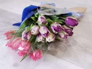 Colorful bunch of loose tulips wrapped in beautiful paper